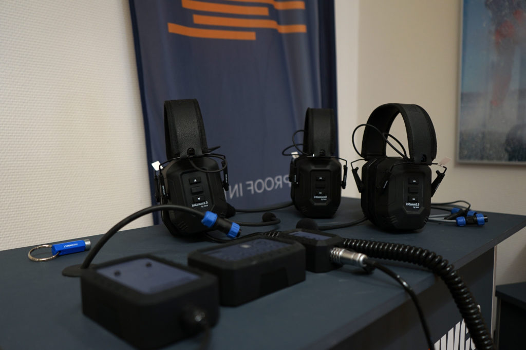 Three iriComm 3.0 headsets on a demostration table.