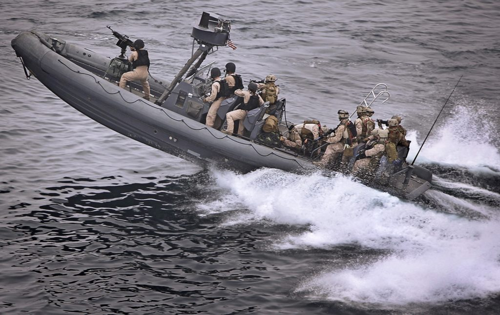 US marines on a high speed ocean vessel