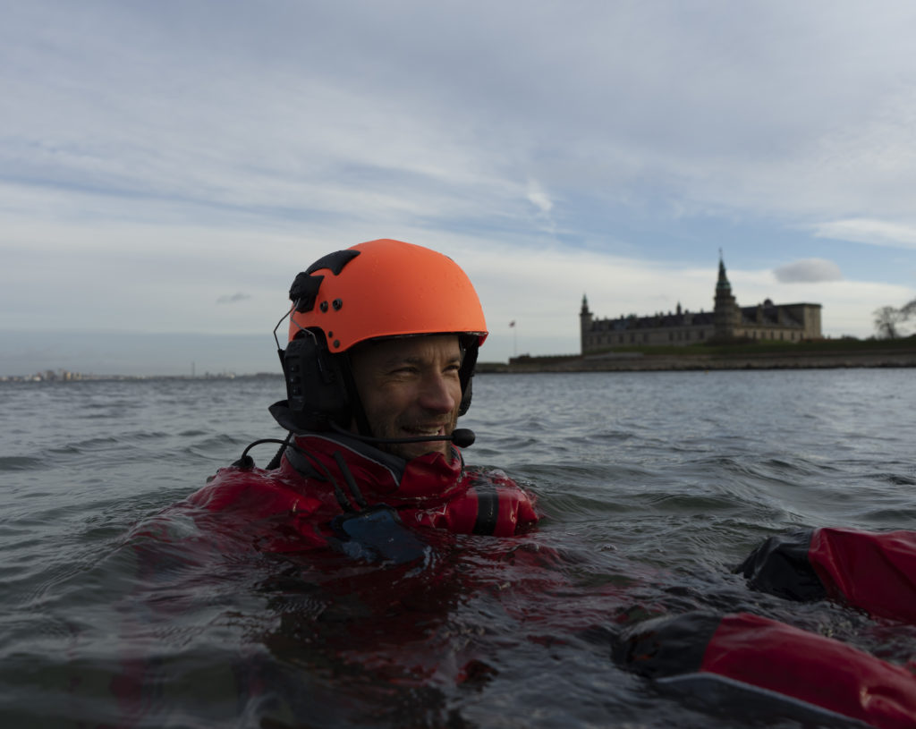 IWCS interns in the water off Kronborg castle in Helsingoer.