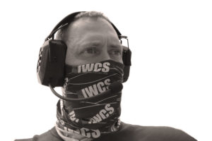 Man with IWCS headset and neckerchief over his face